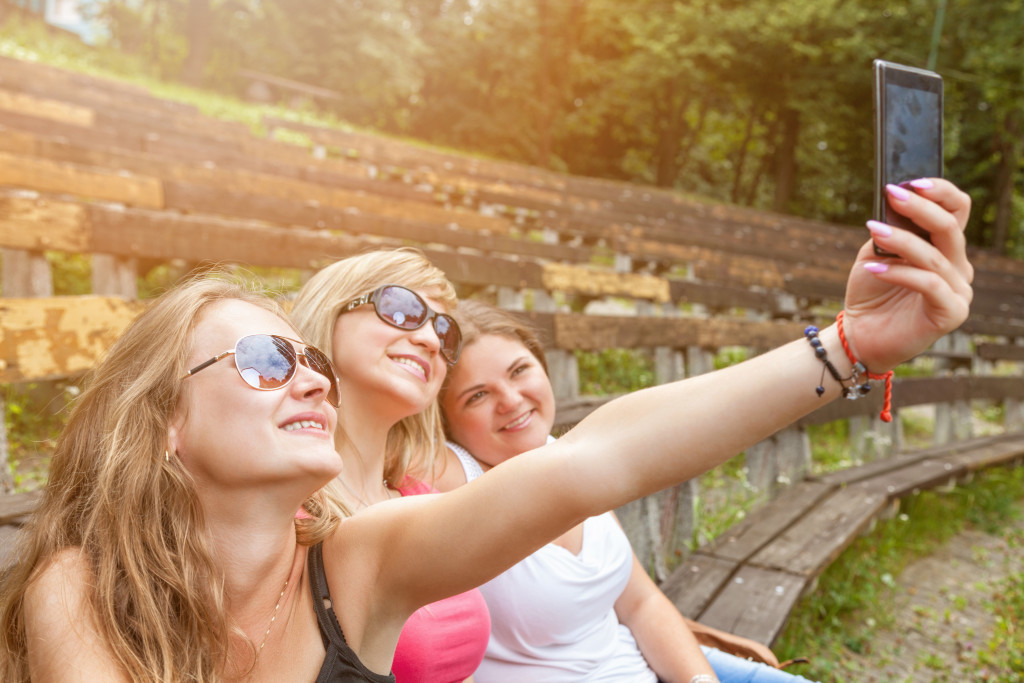 Group of friends taking a selfie outdoors