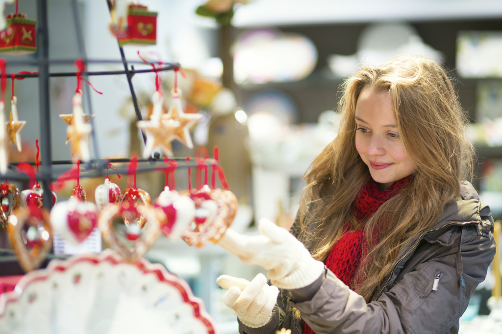 Girl selecting decoration on a Christmas market